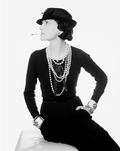 Portrait of Coco Chanel wearing her Maltese Cross Cuffs