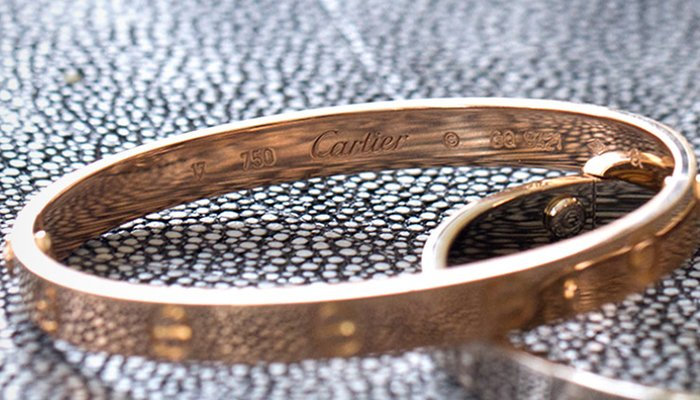 3bc39e47680ea How to Spot a Fake: Cartier Love Bracelet | The Loupe, TrueFacet