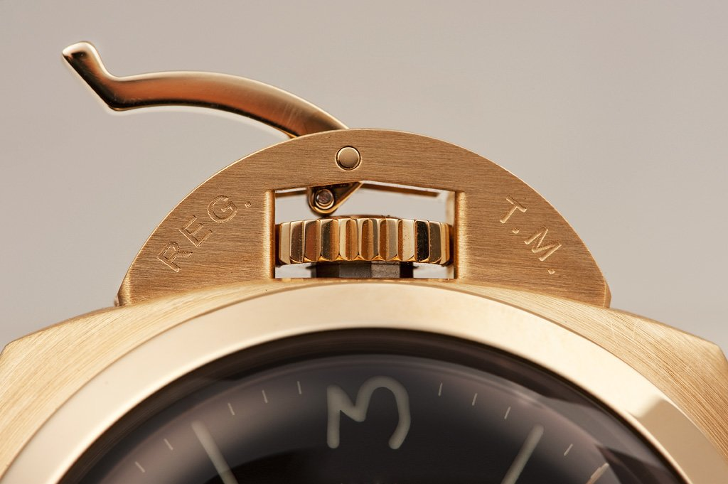 A genuine Panerai crown protector with fine engravings and a handle that fits the protector's curve.