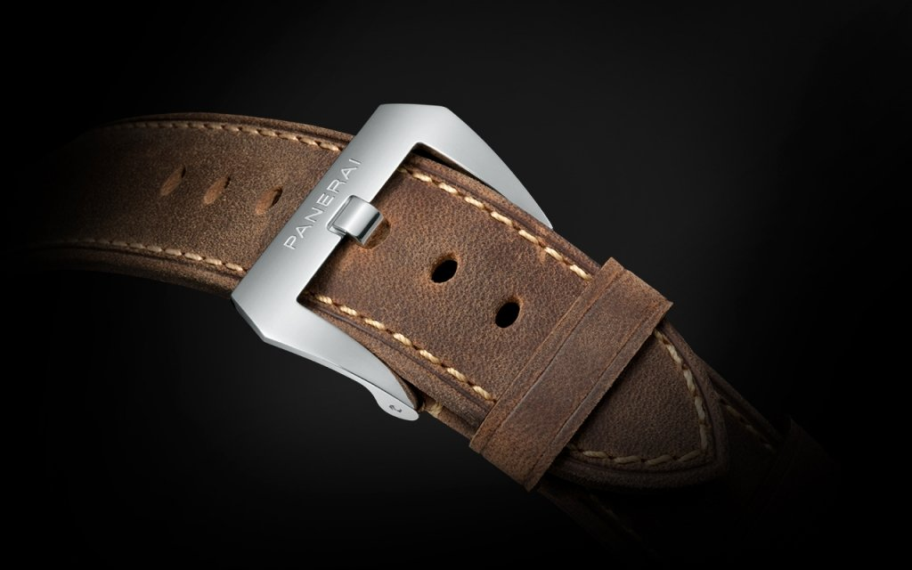 A leather strap with visible seams and the Panerai logo engraved onto the buckle. Photo by Panerai.