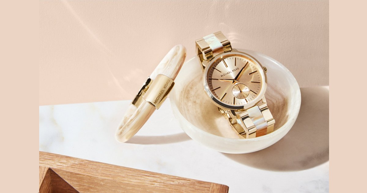 How to spot a fake michael kors watch the loupe truefacet gumiabroncs Gallery