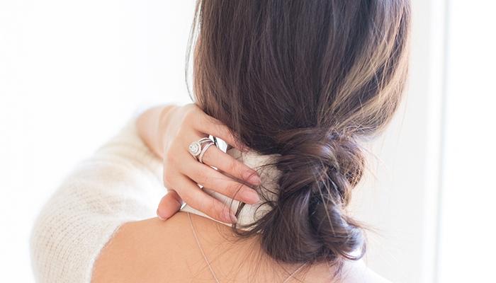 Blogger Peony Lim modeling engagement rings by Jenny Packham