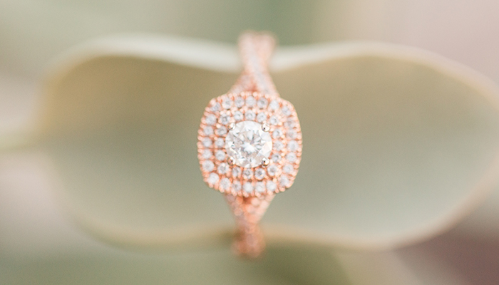 Rose gold engagement ring with two diamond halos
