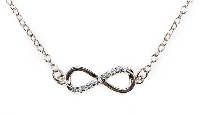 Silver infinity pendant with blue diamonds on a chain