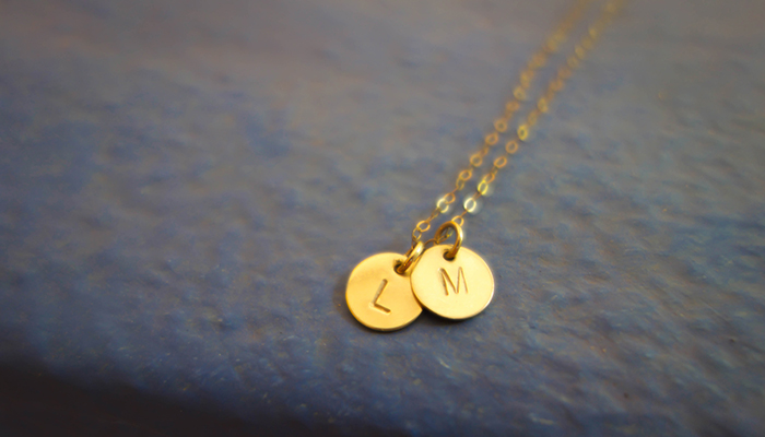 Yellow gold pendant necklaces engraved with initials