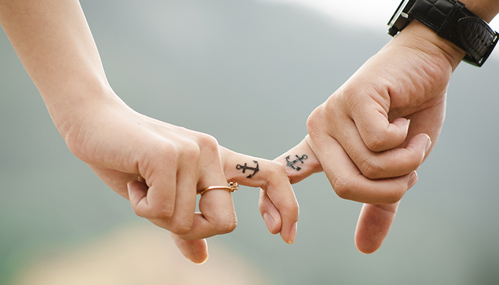 Newlywed couple with anchor bridal tattoos