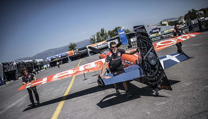 Members of Team Hamilton push the airplane of Nicolas Ivanoff of France during training day at the second round of the Red Bull Air Race World Championship in Cannes, France on April 20, 2018.