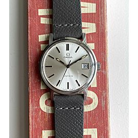 Vintage Omega Geneve Manual Wind Sunburst Silver Dial Quickset Date Steel Watch