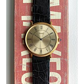 Piaget 18K Yellow Gold Manual Wind Champagne Roman Numeral Dial Coin Bezel Watch