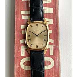 Vintage Patek Philippe 18K Yellow Gold Tank Manual Wind Champagne Dial Watch