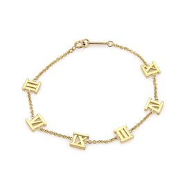 Tiffany & Co. Atlas 18K Yellow Gold 6 Roman Numeral Charms Chain Bracelet