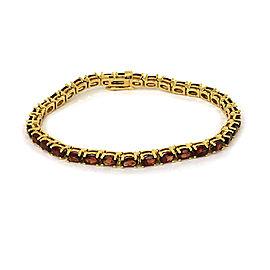 Oval Garnet 14k Yellow Gold Tennis Bracelet