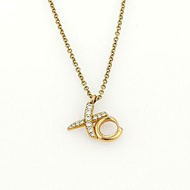 Tiffany & Co. Picasso Diamond Hug & Kiss XO 18K Yellow Gold Pendant