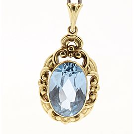 14k Yellow Gold Oval Blue Topaz Ornate Pendant Charm