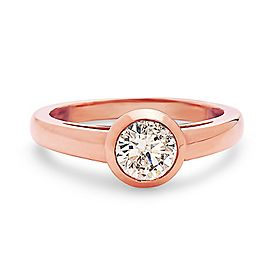14K Rose gold bezal set cartier style solitaire diamond engagement ring.