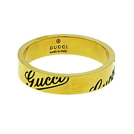 Gucci logo thin band ring in 18k yellow gold size 6.5