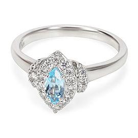Diamond Halo Blue Topaz Ring in 14K White Gold 0.62 ctw