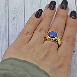 14k Yellow Gold Mens ring features main Star Sapphire.
