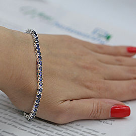 White Gold Tennis Bracelet features 47 Round cut Blue Sapphires in 9.00ct TCW