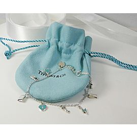 Tiffany & Co. Love Notes Dangle Blue Charm Bracelet RETIRED