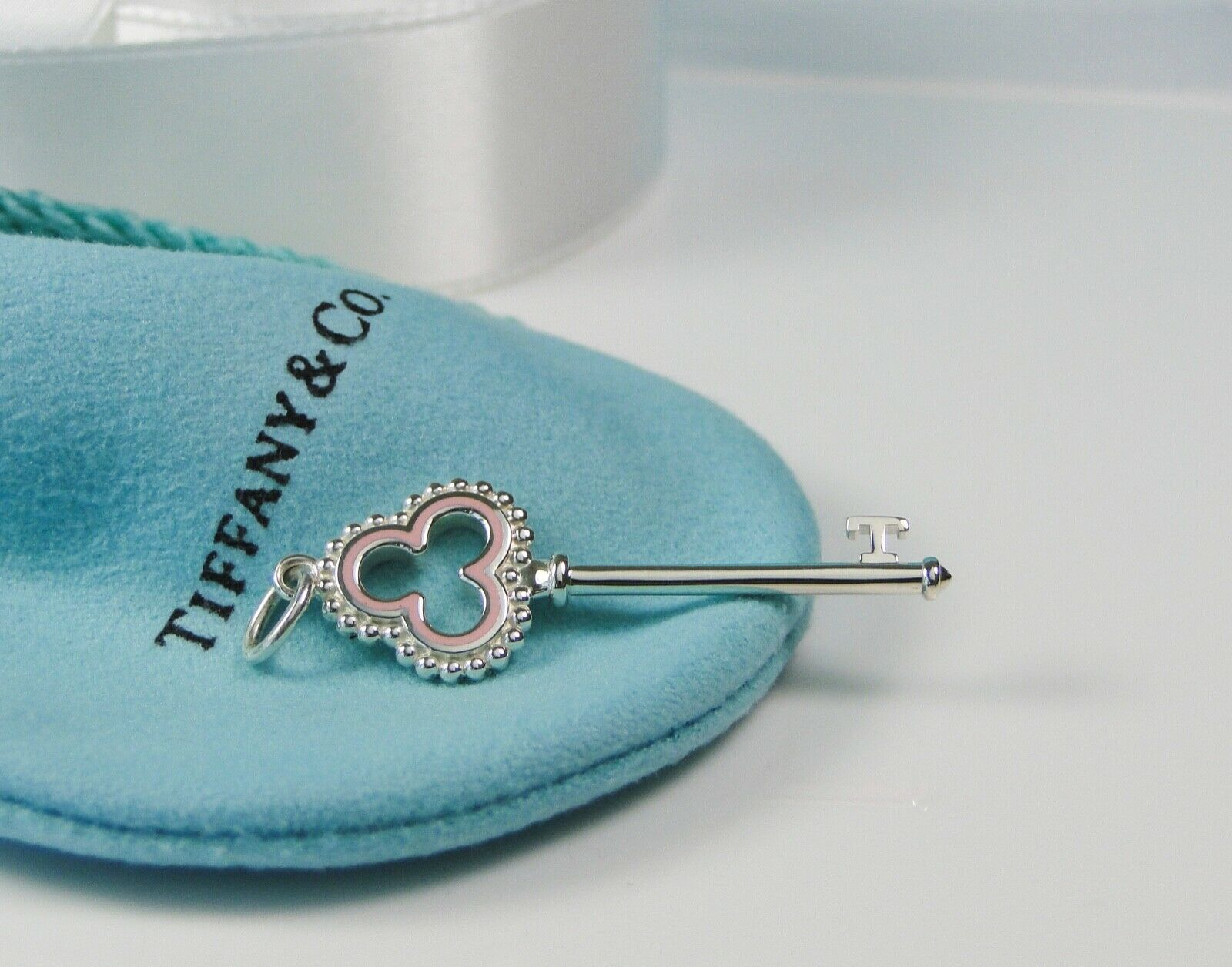 86bbfb1ba9515 Tiffany & Co Silver Bead Pink Enamel Open Trefoil Key Pendant Charm Retired