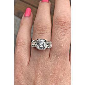 Amazing Platinum Three-stone Engagement Ring features 5.07ct. TWD