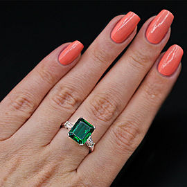 Platinum Cocktail Ring features with 6.00ct. Green Emerald and 0.50ct. Diamonds
