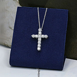 14k White Gold Cross Pendant features 11 Round cut diamonds in 2.15ct of TCW
