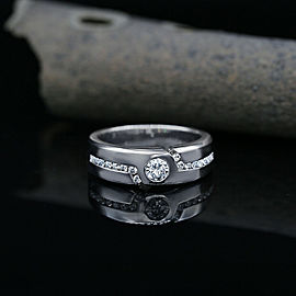 14k White Gold Wedding Band Features 0.36ct center and 0.34ct side Diamonds