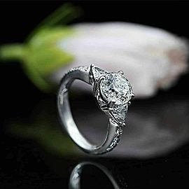 Three-Stone Engagement Ring with Center 2.34ct Round Diamond