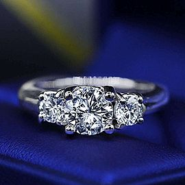 Three-stone Platinum Engagement Ring with 1.00ct Center Round Diamond