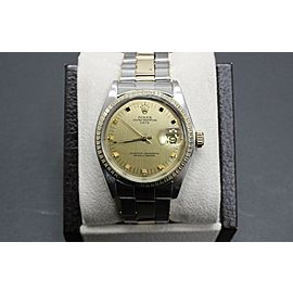 Rolex Date 1505 Collectible 14K Yellow Gold & Stainless Steel Engine Turn Bezel
