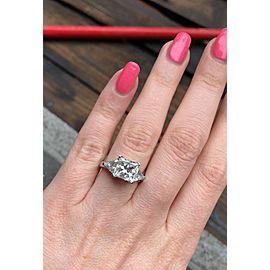 Platinum AGI Certified Three-stone Engagement Ring features 4.51ct. TCW Diamonds