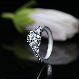 Three-Stone Engagement Ring with Center 2.34ct. Round Diamond
