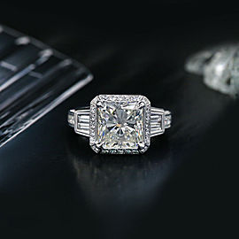 18k White Gold Engagement ring features 6.45ct. Diamonds