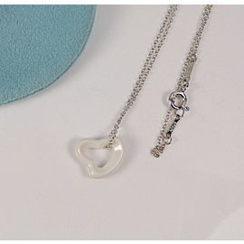 Tiffany & Co Elsa Peretti White Chalcedony Carved Open Heart Pendant Necklace