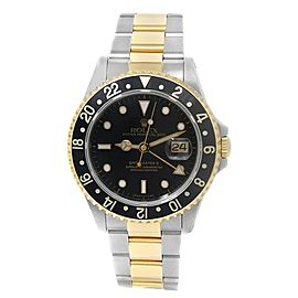 Rolex GMT-Master II 18k Yellow Gold Stainless Steel Oyster Black Watch 16713