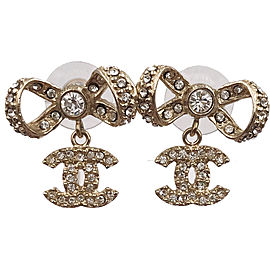 Chanel Gold Tone Hardware with Rhinestone Ribbon Bow CC Piercing Earrings