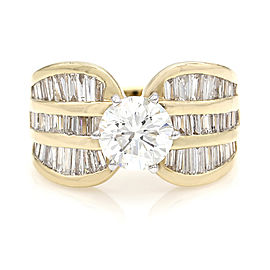 Round and Baguette Diamond Ring in Gold