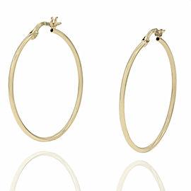 Thin Hoop Earrings in Gold