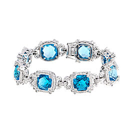 Eye-catching 14k White Gold Blue Topaz Diamond Bracelet