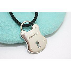 Tiffany & Co. Sterling Silver Lock Key Hole Pendant Silk cord Necklace