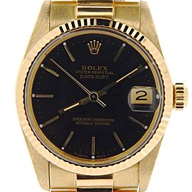 Pre Owned Mid-Size Rolex Yellow Gold Datejust President with a Black Dial 6827