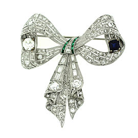 Platinum with 4.15ctw. Diamond and 0.75ctw. Sapphire. Ribbon Brooch-Pendant