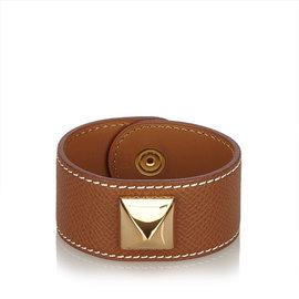 Hermes Medor Leather and Gold Tone Hardware Bracelet