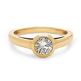 14K Yellow gold bezal set cartier style solitaire diamond engagement ring.