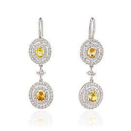GIA Certified 1.33 Carat Total Oval Fancy Yellow Diamond Dangle Earrings