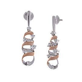 1.07 Carat Total Swirling Dangle Two-Tone Earrings in 18 Karat Gold