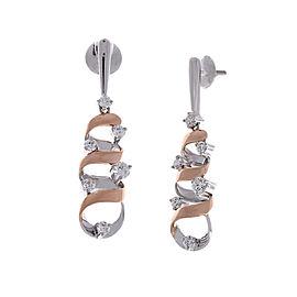 1.07 Carat Total Swirling Dangle Two-Tone Earrings in 18 Karat Gold