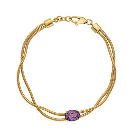 Yellow gold bracelet with pink sapphire